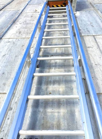 Ladder With Low Level Handrails On Lead Roll Roof