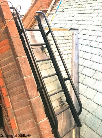Ladder With Low Level Handrails Over Slate Dormer